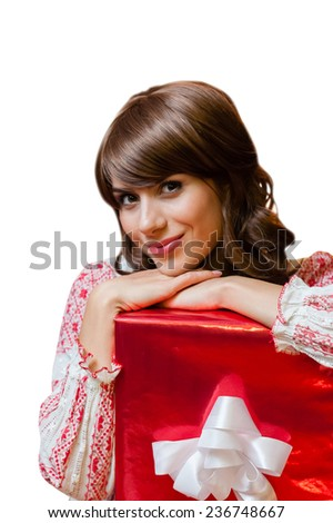 Christmas woman portrait hold red christmas gift isolated over white background - stock photo