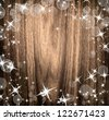Christmas wooden background with many stars and bokeh - stock photo