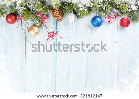 Christmas wooden background with snow fir tree and decor. View with copy space - stock photo
