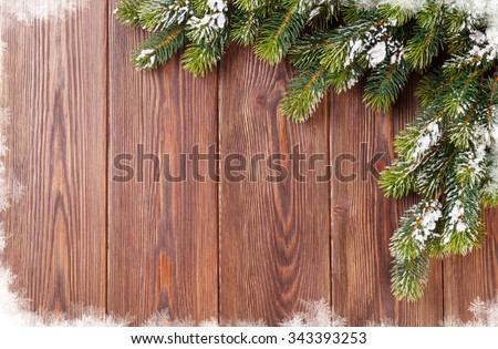 Christmas wooden background with snow fir tree. View with copy space - stock photo