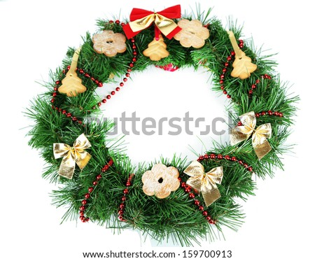Christmas wreath decorated with cookies isolated on white - stock photo