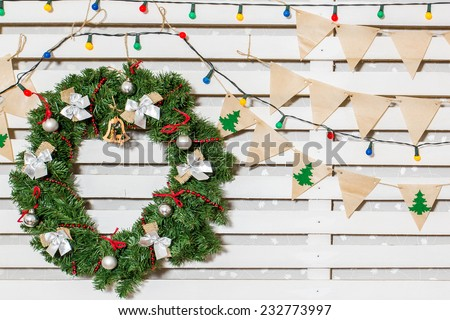 Christmas wreath, holiday decorations, garlands lights, flags, kraft - stock photo
