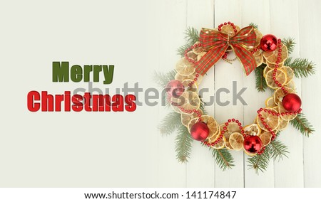 Christmas wreath of dried lemons with fir tree and balls - stock photo