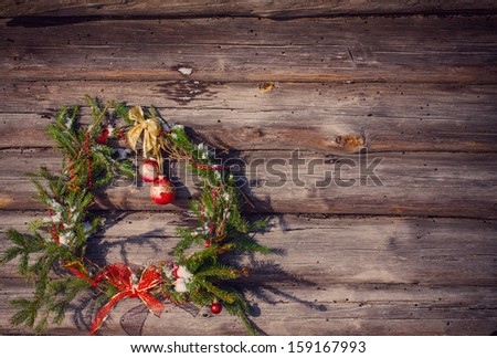 Christmas wreath on a rustic wooden background - stock photo