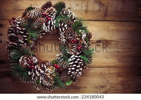 Christmas wreath on a rustic wooden front door - stock photo