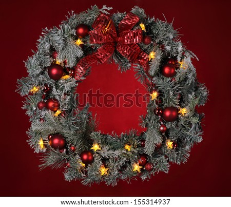 Christmas wreath on red background - stock photo