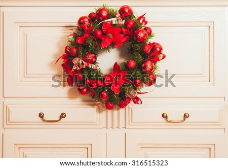 Christmas wreath on the furniture in the room. Home decor - stock photo