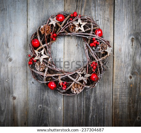 Christmas wreath on wooden background - stock photo