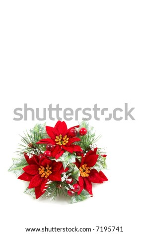 Christmas wreath, poinsettia flowers, leaves and berries on a snowy setup. Vertical, portrait orientation - stock photo