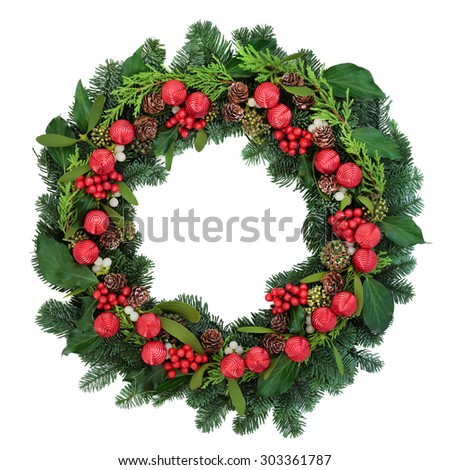 Christmas wreath with red bauble decorations, holly, ivy, mistletoe and winter greenery over white background. - stock photo