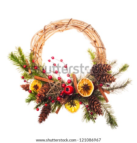 Christmas wreath with red berries and spices - stock photo