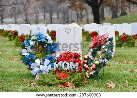 Christmas wreathes rounding a mom soldier's gravestone - Arlington National Cemetery - Washington DC  - stock photo