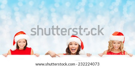 christmas, x-mas, people, advertisement and sale concept - happy women in santa helper hat with blank white board over blue lights background - stock photo