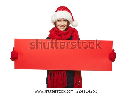 Christmas, X-mas, Xmas sale, shopping concept - Smiling woman wearing Santa hat with red sale sign - empty copy space for your text, looking at camera - stock photo