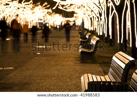 christmastime with seasonal lighting in berlin at night - stock photo