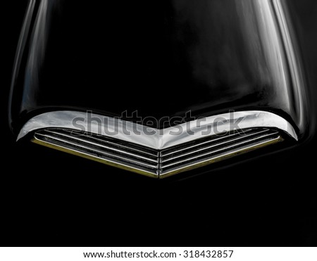 Chrome air scoop on hood of black automobile. - stock photo