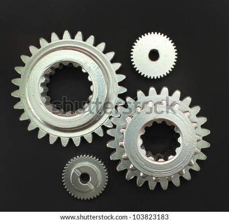 chrome gear black background - stock photo