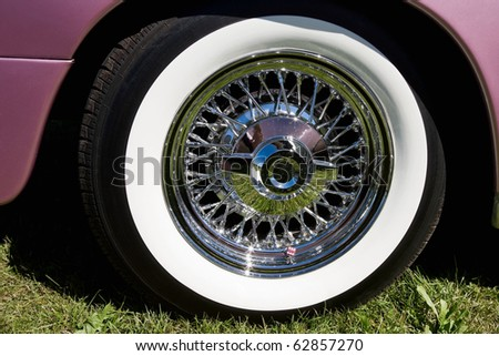 Chrome rims with whitewall tire - stock photo