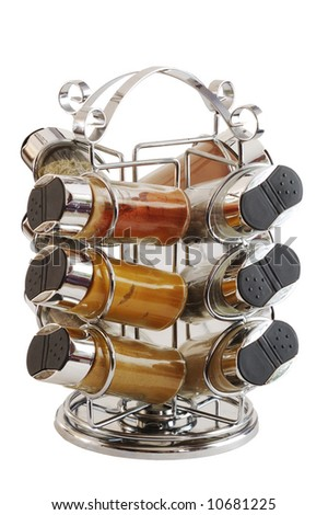 Chrome spices rack containing 12 bottles with different kinds of spices isolated on white - stock photo