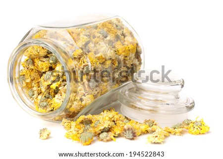Chrysanthemum tea  in   glass jars  - stock photo