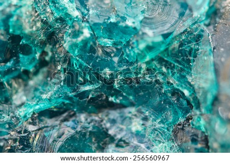 Chrysocolla is a hydrated copper cyclosilicate.Cyan (blue-green) crystal. Macro. Beautiful fantastic background for successful business projects and other Your variant. - stock photo