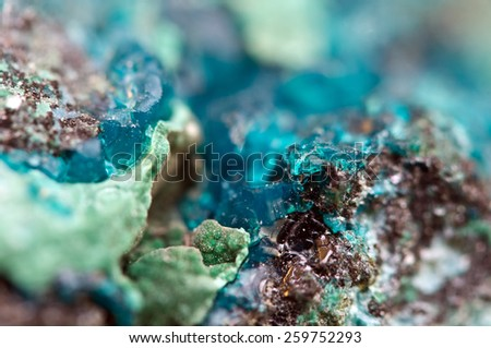 Chrysocolla is a hydrated copper cyclosilicate It has the chemical formula (Cu,Al)2H2Si2O5(OH)4nH2O.Cyan (blue-green) crystal. Macro. Beautiful fantastic background for successful Your projects - stock photo
