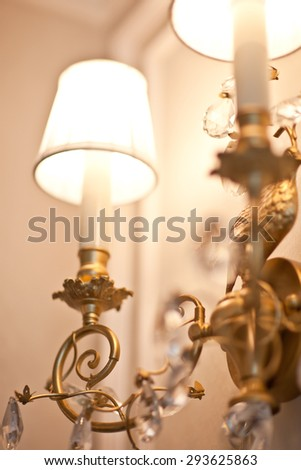 Chrystal chandelier close-up. Glamour lamp with crystal and gold metal - stock photo