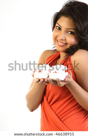 Chubby   Woman dreaming holding her small baby shoes - stock photo