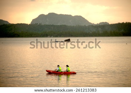 CHUMPHON,THAILAND-APRIL 6 : Tourist canoeing have fun and enjoy the sea near Koh Phitak island in holiday on April 6,2014,Chumphon Province in Southern of Thailand. - stock photo