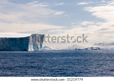 Chunk of ice adrift in the antarctic waters - stock photo