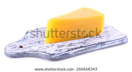 Chunk of Parmesan cheese on wooden cutting board isolated on white - stock photo