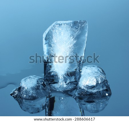 Chunks of ice on reflective surface - stock photo