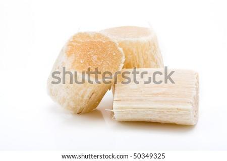Chunks of Raw Sugar Cane against white background. - stock photo