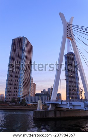 Chuo ohashi bridge and Skyscraper in Tokyo at dusk - stock photo