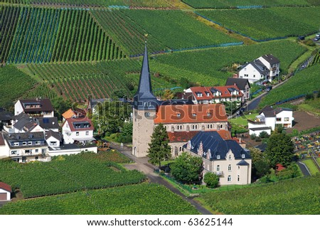 Church & community in vineyards after a rain shower - stock photo