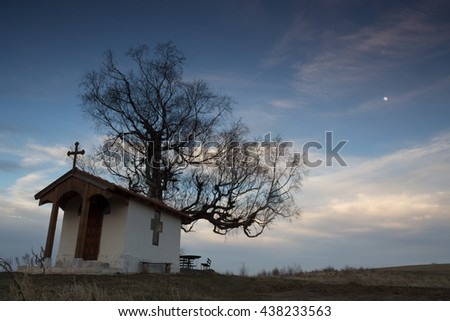 Church, field, tree and sky - stock photo