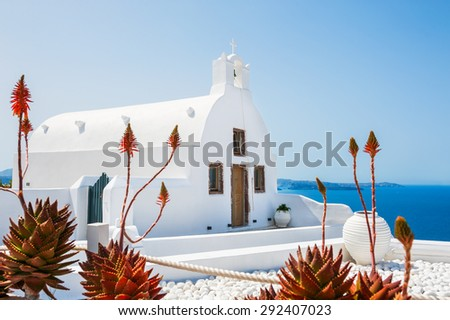Church in Oia town, white architecture on Santorini island, Greece. Beautiful landscape with sea view. Selective focus - stock photo