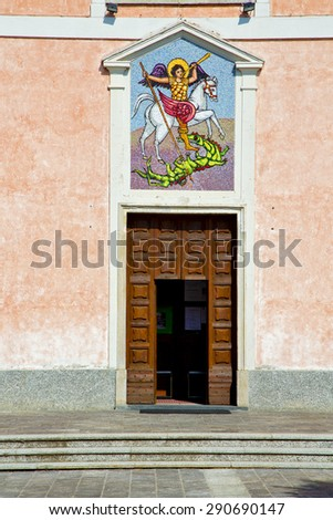 church  mornago varese italy the old door entrance and mosaic - stock photo