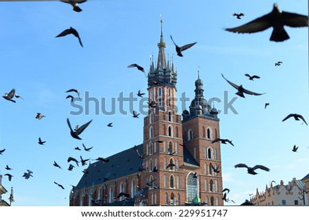Church of Our Lady Assumed into Heaven also known as St. Mary's Church at the Main Market Square in Krakow, Poland. - stock photo