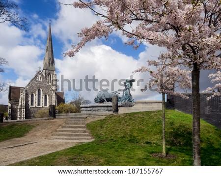 Church of Saint Alban and Aegir fountain in Copenhagen, Denmark - stock photo