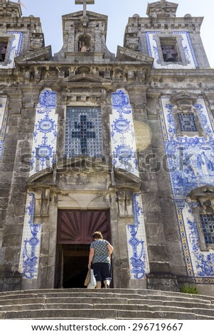 Church of Saint Ildefonso - Igreja de Santo Ildefonso - a 18th century building in Baroque style, covered with typical Portuguese tiles called Azulejos. Unesco World Heritage Site, in Porto, Portugal. - stock photo