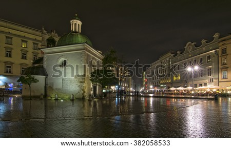 Church of St. Adalbert (Wojciech) and Main Market Square (Rynek Glowny) in Old Town of Krakow, Poland at night  - stock photo