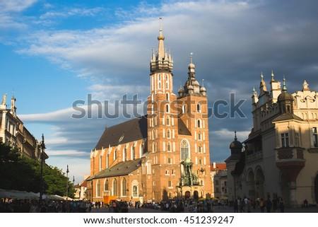 Church of St. Mary and the Cloth Hall on the Rynek Glowny main Market Square in Krakow, Poland. - stock photo