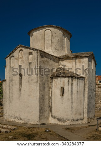 Church of the Holy Cross is a Croatian Pre-Romanesque Catholic church originating from the 9th century in Nin, Croatia. - stock photo