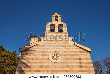 Church of the Holy Trinity in Budva Old Town, Montenegro, at sunset - stock photo