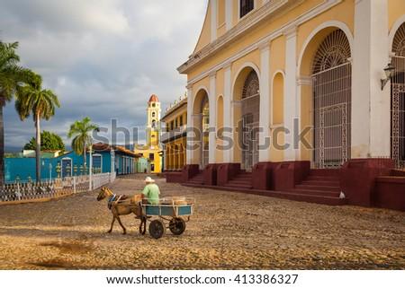 Church of the Holy Trinity overlooking Plaza Mayor,  Trinidad, Cuba - stock photo