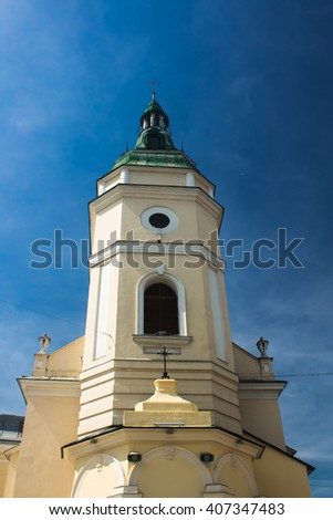 Church. Old architecture religion building with steeple, chapel, cross. Outdoor scenic historic landmark with blue sky, clouds. Exterior of worship house. Traditional europe christian cathedral - stock photo
