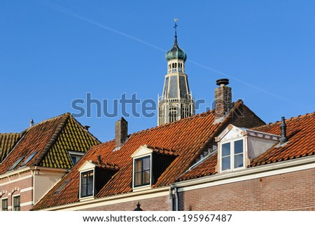 Church over the tiled roofs in the center of Enkhuizen, Netherlands - stock photo