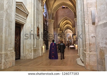 church robes with care and walk through it - stock photo