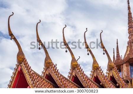 Church sharp gable roof sky cloud in wat tham sua temple - stock photo